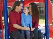 David Hartino '11 shares a moment with his family at the playground.