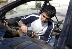 Bhaskar Garg '10 works on Cornell's Automotive X Prize car.