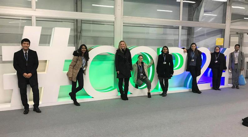 #COP24 sign with members of the Cornell Delegation.